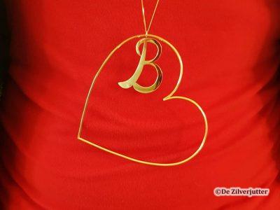 De zilverjutter - Gouden ketting met Harten-B hanger